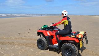 A RNLI lifeguard on a quad