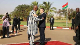 Burkina Faso's President Roch Marc Christian Kabore welcomes France's President Emmanuel Macron at the presidential palace in Ouagadougou on 28 November 2017