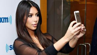 Kim Kardashian taking a selfie