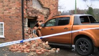Truck embedded into the wall of the house