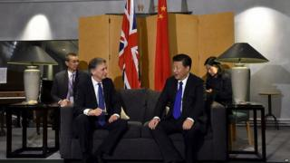 Philip Hammond speaks to Chinese President Xi Jinping after his arrival in the UK