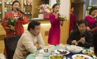 North Korean women perform in a restaurant in Liaoning, China (file image)