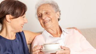 Stock image of an elderly woman and her caregiver