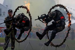 People's Liberation Army soldiers perform during an open day at a naval base in Hong Kong, China/
