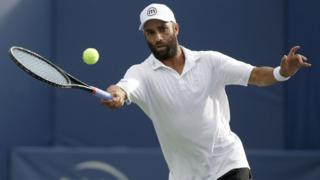 James Blake hits a forehand against Rhyne Williams on August 19, 2013 in Winston Salem, North Carolina.