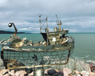 Fishing boat sculpture