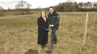 Judith Blake, leader of Leeds City Council, plants the first tree with Adrian Gill, Flood Risk Manager at the Environment Agency