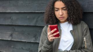 Girl using her mobile phone