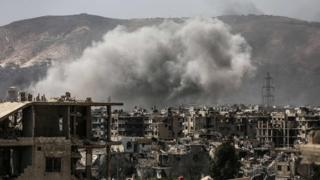 Smoke billows following a reported air strike in a rebel-held part of the Jobar district, on the eastern outskirts of the Syrian capital Damascus, on 19 March 2017