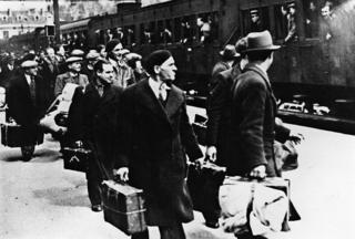 Photo from May 1941 showing foreign Jews, mainly Polish Jews, getting off the train in Pithiviers, France