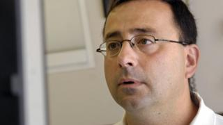Larry Nasser looks at a computer after seeing a patient in this 2008 file photo.