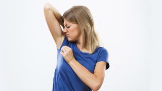 woman sniffing armpits