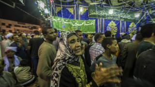 Egyptians perform Sufi rituals outside Cairo's Sayeda Zainab mosque, May 2015