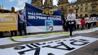 Protesters gather outside Congress in Bogota for the debate. 30 Nov 2016