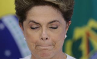 Brazil's President Dilma Rousseff briefly closes her eyes as a governor speaks during a meeting on state land issues, at Planalto presidential palace in Brasilia, Brazil, Friday, April 15, 2016