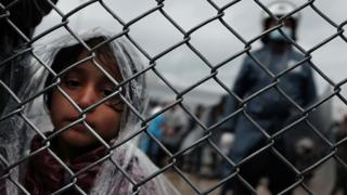 A child waits at the migrant processing centre on the island of Lesbos