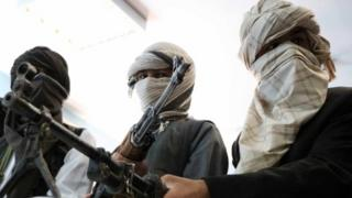 Ex-Taliban militants hand in weapons in Herat