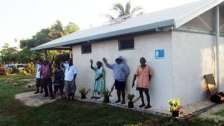 Residents of Paunangisu in front of their public toilet