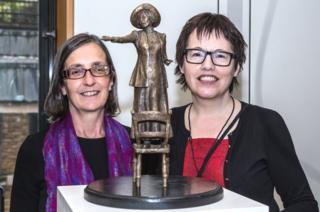 Helen Pankhurst and Hazel Reeves with Emmeline Pankhurst statue maquette
