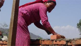 Sanumaya Kumal at building site in Bidur in Nuwakot district