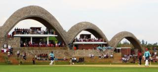 "Sam Billings (right) playing in the T20 tournament final at the new cricket stadium in Kigali, Rwanda, which has been dubbed the ""Lord""s of East Africa""."