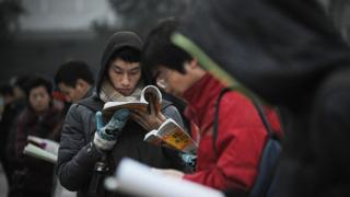 Students read before sitting the National Entrance Examination for Postgraduate (NEEP) at a university in Beijing on January 4, 2014.