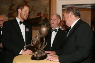 Prince Harry, sculptor Les Johnson and Vernon Monument project manager David Sandiford (right)