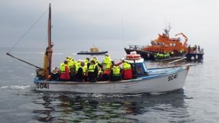 Passengers wearing lifejackets
