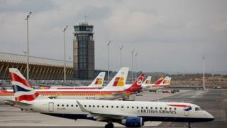 A British Airways plane in front of Iberia's planes in Madrid