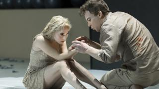 "Sophia Anne Caruso, left, and Michael C. Hall perform in a scene from David Bowie and Enda Walsh's ""Lazarus,"" currently performing off-Broadway at the New York Theatre Workshop in New York"