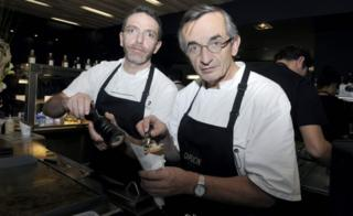 French chef Michel Bras (R) at work with his son, Sebastien Bras