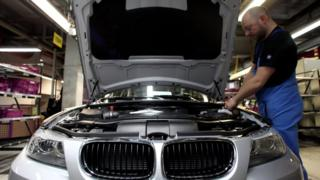 A man checks a car on the BMW 3-series production line at the BMW factory on March 15, 2010 in Munich, Germany.