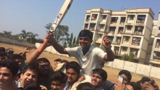 Pranav Dhanawade's teammates celebrating his achievement