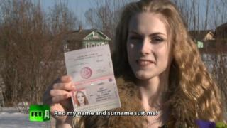 Kira Sadovaya is shown with a new passport, identifying her as female