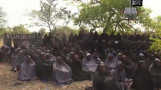 """-In this file photo taken from video released by Nigeria""""s Boko Haram terrorist network, Monday May 12, 2014, shows missing girls abducted from the northeastern town of Chibok."""