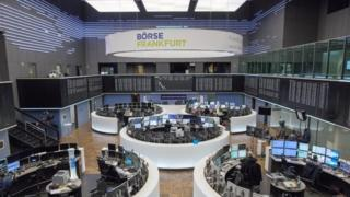 Traders work on the floor of the stock exchange in Frankfurt am Main, Germany, 27 February 2017
