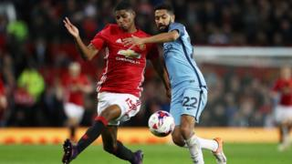 Marcus Rashford of Manchester United (L) and Gael Clichy of Manchester City (R) conflict for possession of a ball