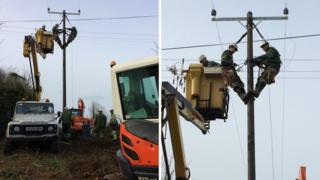 Scottish Power engineers work to restore power lines in Anglesey