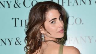 Woman wearing Tiffany earrings