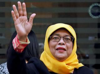Former speaker of Singapore's parliament, Halimah Yacob, arrives at the Elections Department after she was given the certificate of eligibility to contest the election by the Presidential Elections Committee in Singapore 11 September 2017.