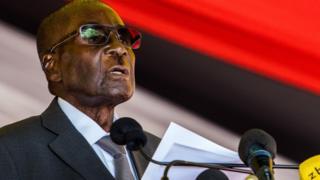 Zimbabwe's President Robert Mugabe speaks during the burial of Brigadier General James Murozvi, who was granted national hero status by President Robert Mugabe, at the National Heroes Acre in Harare, on April 12, 2017. / AFP PHOTO / Jekesai NJIKIZANA (Photo credit should read JEKESAI NJIKIZANA/AFP/Getty Images)