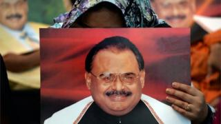 """Supporters of Pakistan""""s Muttahida Qaumi Movement (MQM) party hold photographs of party leader Altaf Hussain as they stage a sit-in calling for his release in Karachi on June 3, 2014."""