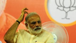 Indian Prime Minister Narendra Modi gestures as he prepares to address an election rally of Bharatiya Janata Party(BJP)supporters at The YMCA Grounds in Chennai on May 6, 2016, ahead of voting in state assembly elections in the southern Indian state of Tamil Nadu