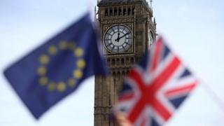 The Union Jack and EU flag in front of Big Ben