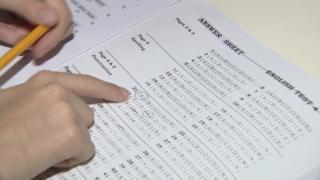 Pupil sitting transfer test exam