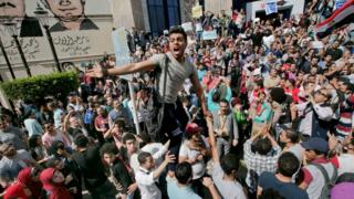 Egyptians shout slogans against Egyptian President Abdel-Fattah el-Sissi during a protest against the decision to hand over control of two strategic Red Sea islands to Saudi Arabia in front of the Press Syndicate, in Cairo, Egypt, Friday, April 15, 2016.
