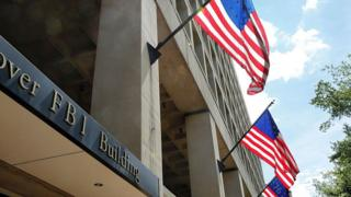 The FBI headquarters in Washington DC pictured with US flags