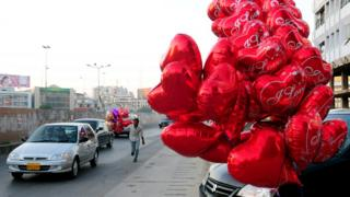File photo: Heart shaped balloons on a street in Karachi, 14 February 2011