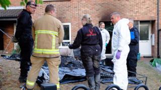 Investigators at the fire scene