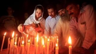 Peshawar mourners hold a candle-lit vigil after the Quetta attack